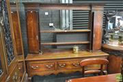 Sale 8282 - Lot 1034 - George III Oak & Mahogany Banded Dresser, the top with open shelves & cupboards, three large drawers & cabriole legs (cornice later,...