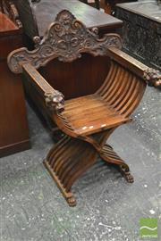 Sale 8359 - Lot 1080 - Carved Walnut Savonarola Style Chair, with lion motifs to back and arm terminals, raised on paw feet