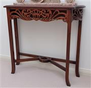 Sale 9005H - Lot 31 - A mahogany console table with pierced apron and stretcher base, Height 76cm x Width 82cm x Depth 26cm