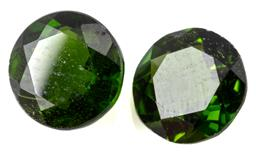 Sale 9132 - Lot 574 - A PAIR OF UNSET CHROME DIOPSIDE; total wt. 1.53ct, round cut, 5.95 x 3.08mm.
