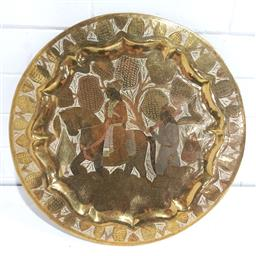 Sale 9152 - Lot 2602 - Ornate etched brass plate depicting rider and companion (d42cm)