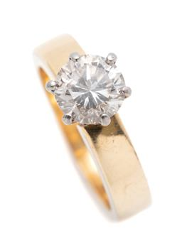 Sale 9260H - Lot 400 - A solitaire diamond ring; claw set in white gold with a round brilliant cut diamond of approx. 1.61ct P1/K-L (2 dints & surface reac...