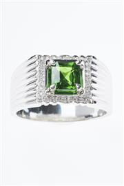 Sale 8322J - Lot 385 - AN 18CT WHITE GOLD GEMSET RING; centring a square radiant cut demantoid garnet to surround of 32 round brilliant cut diamonds on wid...