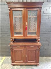 Sale 9014 - Lot 1061 - Early 20th Century French Walnut Buffet a Deux Corps, the two upper glass panel doors etched with trophies of the arts, with two dra...