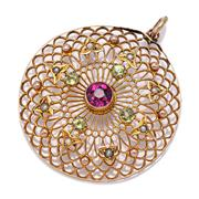 Sale 9083 - Lot 347 - A 9CT GOLD VINTAGE GEMSET PENDANT; 30m round pierced lattice work disc centring a round cut rhodolite garnet surrounded by small per...
