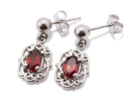 Sale 9253J - Lot 483 - A PAIR OF SILVER GARNET EARRINGS; each an approx. 0.40ct oval cut garnet set in a scroll frame to a beaded post and butterfly fittin...