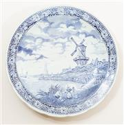 Sale 8926K - Lot 99 - A Boch style blue and white charger with windmill scene, D 39cm