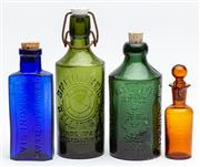 Sale 9054E - Lot 53 - A group of four vintage coloured glass bottles with impressed marks  including CF Johnson, Sydney,  Granulate citrate of magnesia, L...