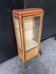 Sale 9068 - Lot 1023 - Transitional French Style Vitrine, having applied brass mounts, with stepped top, glass panel door with floral panel below & cabriol...