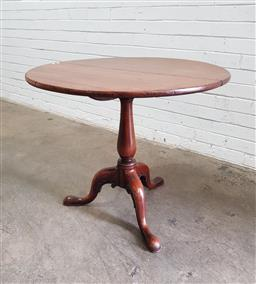 Sale 9126 - Lot 1039 - George III Mahogany Wine Table, the round top above a turned pedestal, with three outswept feet with scroll flourishes (h:73 x d:83cm)