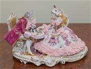 Sale 8368A - Lot 41 - A German porcelain figural group in pink tones of a couple playing chess, H 18 cm
