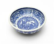 Sale 8844 - Lot 2 - A Kakiemon blue and white bowl printed with tiger and bamboo amidst blossom. Diameter 24.5cm