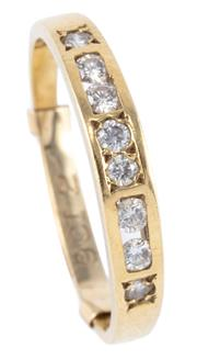 Sale 8974 - Lot 304 - AN 18CT GOLD DIAMOND RING; channel and gypsy set with 8 round brilliant cut diamonds totalling approx. 0.25ct, size Q, wt. 2.63g.