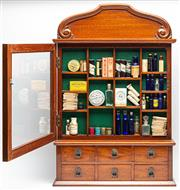 Sale 9054E - Lot 54 - A Victorian mahogany and brass pharmacy display cabinet and contents. with glass door above six drawers. Height 84 x 56 x 11cm