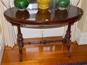 Sale 7997 - Lot 86 - AN ANTIQUE MAHOGANY OVAL TABLE RAISED ON TURNED COLUMNS ON CABRIOLE LEGS JOINED BY STRETCHERS C. 1860