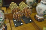 Sale 8331 - Lot 1498 - Set of Four Faux Turtle Shells on Stand