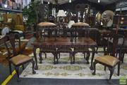 Sale 8338 - Lot 1425 - Carved Imbuia Dining Setting incl. Table on Ball & Claw Feet Together with Set of Eight Chairs