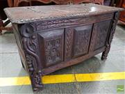 Sale 8485 - Lot 1061 - 17th Century Style Carved Oak Coffer, with carved panels & grape vine stile feet