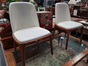 Sale 8744 - Lot 1030 - Set of Four Leather Dining Chairs over Timber Base