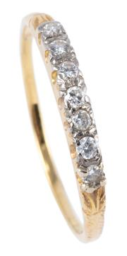 Sale 8974 - Lot 301 - AN 18CT GOLD DIAMOND RING; set with 7 round brilliant cut diamonds totalling approx. 0.12ct, size S - T, wt.1.82g.