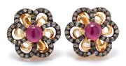 Sale 9029 - Lot 332 - A PAIR OF RUBY AND DIAMOND FLORAL CLUSTER STUD EARRINGS; each a 1.02ct cabochon ruby surrounded by single cut diamonds totalling 1.1...