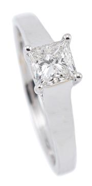 Sale 9083 - Lot 425 - AN 18CT WHITE GOLD SOLITAIRE DIAMOND RING; bead claw set with a princess cut diamond of 0.63ct, G - P1, size M 1/2, width 4.8mm, wt....