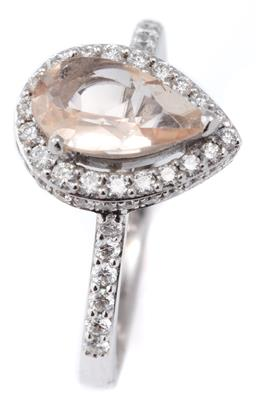 Sale 9124 - Lot 390 - AN 18CT WHITE GOLD MORGANITE AND DIAMOND RING; bead claw set with a pear cut pale morganite of approx. 0.90ct above surround, galler...