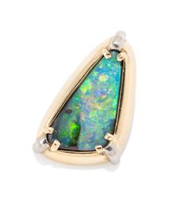 Sale 9177 - Lot 361 - AN 18CT GOLD BOULDER OPAL PENDANT; free form polished opal with good play of colour, size 15 x 10mm. wt. 2.30g.