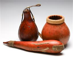 Sale 9253 - Lot 324 - African drinking gourds (L: 55cm & 31cm), together with a potted vase (H: 26cm)