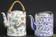 Sale 8586 - Lot 133 - Famile Rose Teapot And A Blue And White Example