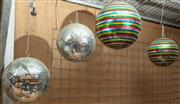 Sale 8984H - Lot 358 - Two pairs of mirrored disco balls, the larger coloured diameter 37cm