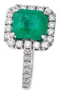 Sale 9124 - Lot 464 - AN EMERALD AND DIAMOND RING; featuring a square emerald cut emerald of approx. 2.88ct to surround and shoulders set with 32 round br...