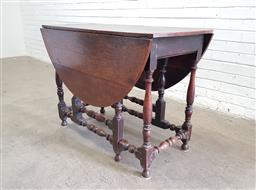 Sale 9126 - Lot 1175 - 18th Century Oak Gate-Leg Table, forming an oval top, raised on turned legs with stretchers (h76 x w182 x d85cm)