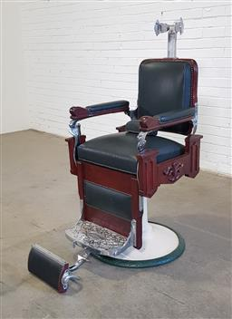Sale 9171 - Lot 1009 - National barbers chair with nickel plate foot rest, timber frame and leather upholstery (h125 x w61 x d48cm)