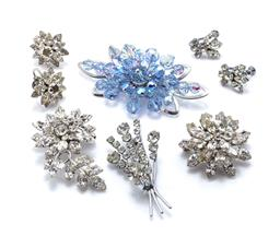 Sale 9221 - Lot 313 - FOUR VINTAGE STONE SET BROOCHES PLUS EARRINGS; 2 brooches by Jewlcrest incl. blue crystals in box, size 72 x 42mm, and flower with l...