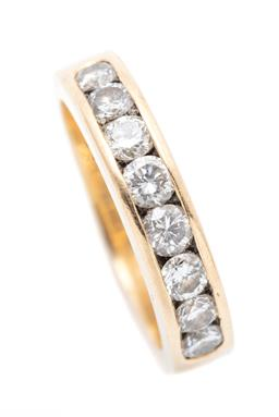 Sale 9260H - Lot 311 - An 18ct gold half hoop diamond ring; channel set with 8 round brilliant cut diamonds totalling approx. 0.80ct SI1-P1, width 4.5mm, s...