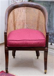 Sale 8550H - Lot 196 - An English Regency caned tub chair c1810, with a combed rosewood finish to beechwood frame, with spiral carved arms, a hand caned se...