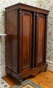 Sale 8649A - Lot 57 - An early C19th mahogany wardrobe with two arched panel drawers with attached columns raised on bun feet with castors, H 180 x W 105 ...