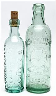 Sale 9054E - Lot 58 - An aqua glass bottle with bubble inclusion for Marchants Ltd (Australia) and wheel design together with another for M Cassidy, The B...