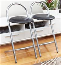 Sale 9080H - Lot 66 - Two Chrome stools with round black seat. height of seat 66cm total height of stool 90cm