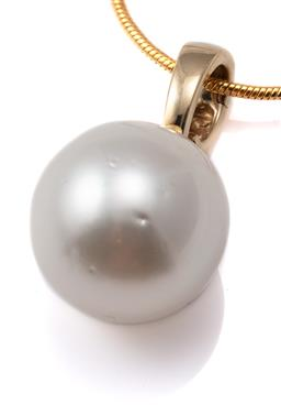 Sale 9124 - Lot 477 - A SOUTH SEA PEARL ENHANCER; featuring a 16.2mm round cultured pearl of good colour and lustre with few light spots on 9ct gold bale...