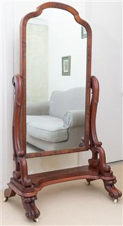Sale 8550H - Lot 211 - An antique English mahogany cheval mirror C: 1860, with a shaped swinging mirror on S scroll carved supports on four scrolled, fee...