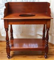 Sale 8649A - Lot 60 - A Victorian style cedar washstand with a high shaped back and receptacle raised on turned legs joined by a shelf, H 94 x W 76 x D 46cm