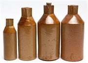 Sale 9054E - Lot 59 - A group of four Doulton Lambeth stoneware ink bottles with square necks. Tallest 22cm.