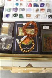 Sale 8139 - Lot 2256 - 2 String Baltic Amber + Book