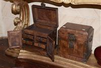 Sale 8171A - Lot 8 - A rare matching pair of huanghuali table top chests, Guanpixiang, of rectangular form with a bail handle on each side, double front...