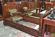 Sale 8282 - Lot 1046 - Pair of 19th Century French Plum Pudding Mahogany Single Beds, with octagonal posts & turned finials