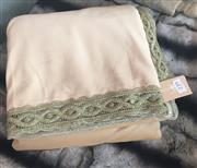Sale 8310A - Lot 239 - A velvet bedspread in pistachio with gold lace edging
