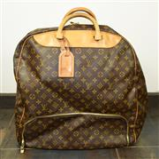Sale 8460F - Lot 41 - A Louis Vuitton, Paris, Evasion weekend bag, classic LV monogrammed soft shell , with additional shoe protector/ compartment, closed...