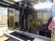 Sale 8464 - Lot 2233 - Sony TV with Remote